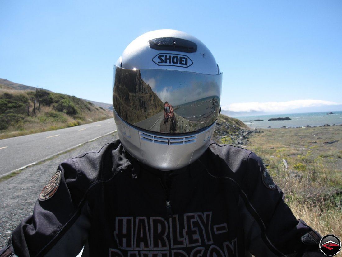 Dave reflected in the mirrored visor of Toms Shoei helmet; meta photo
