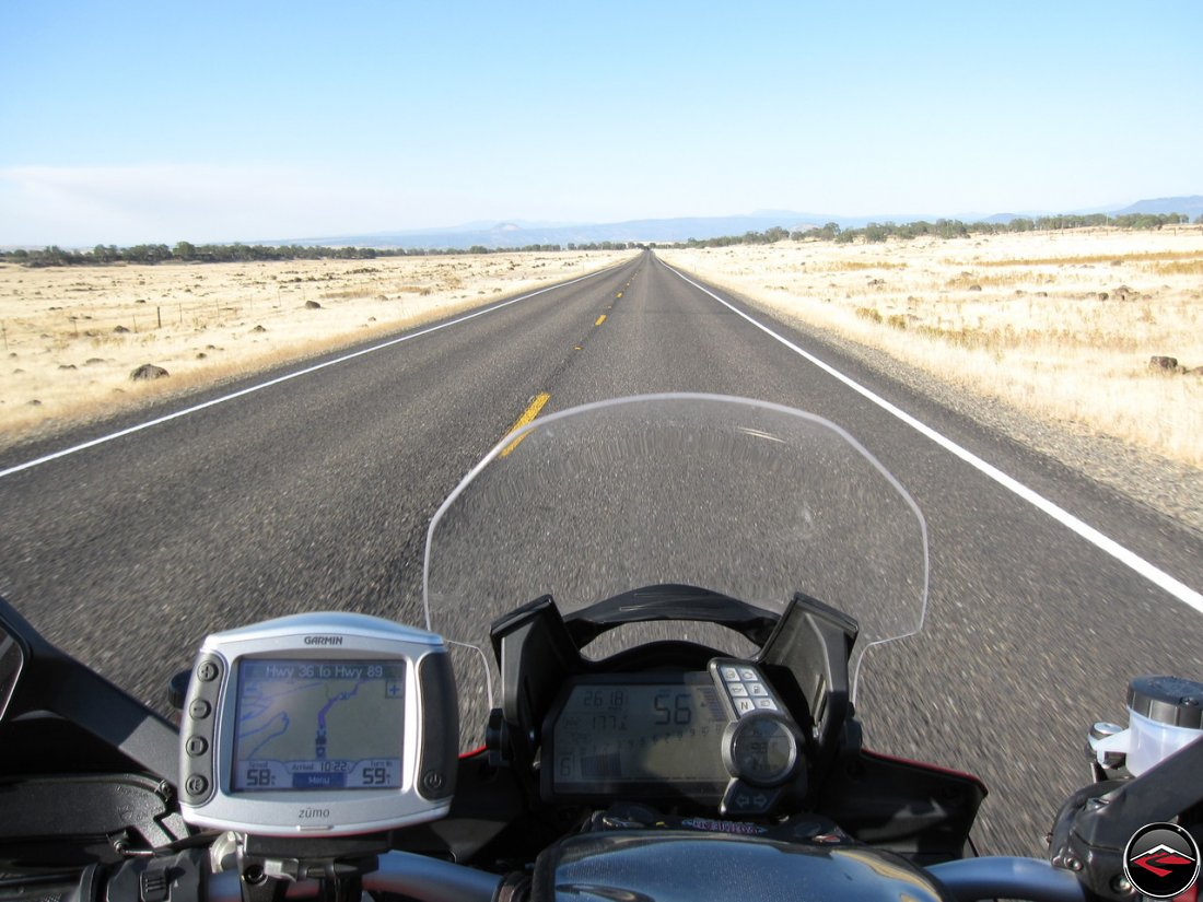 Ducati Multistrada 1200 dashboard, guages, speedometer, with a Garmin Zumo 450, staring down a long, lonesome California Highway 36, east of Quincy, Califorinia