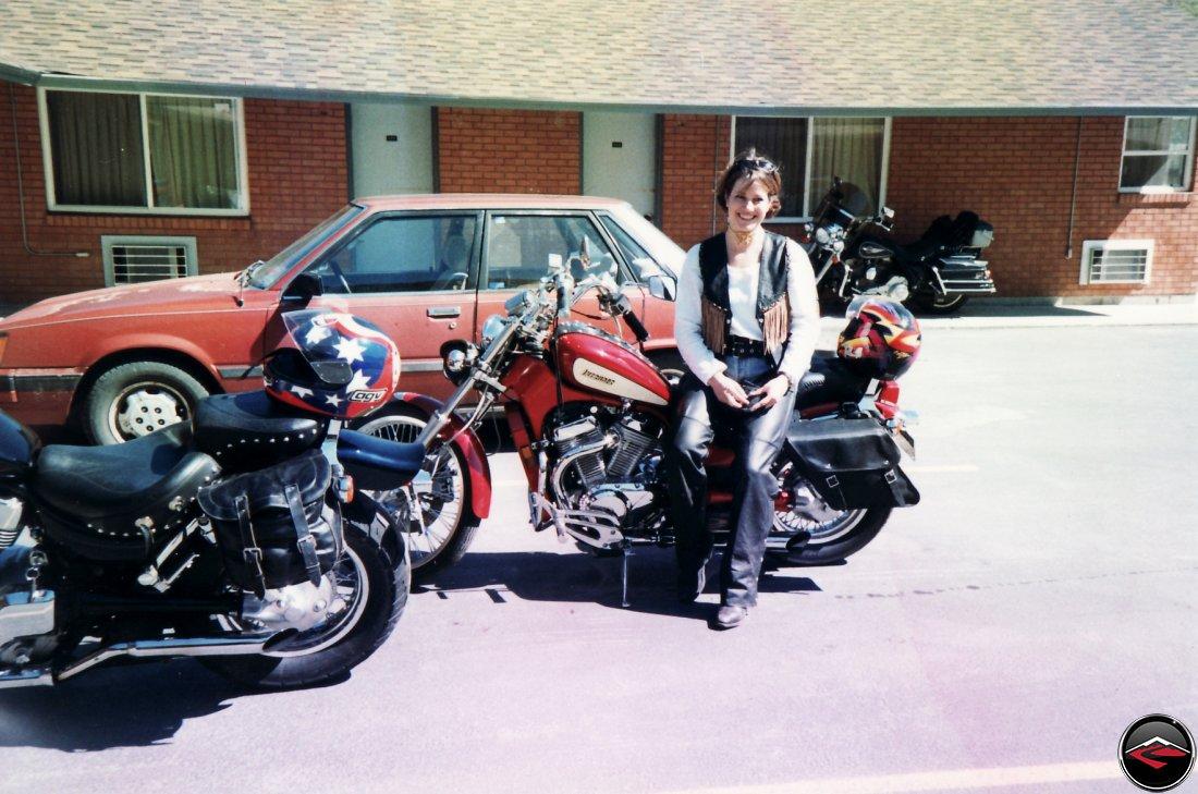 Pretty girl sitting on a Suzuki Intruder 800 in Sundance, Wyoming