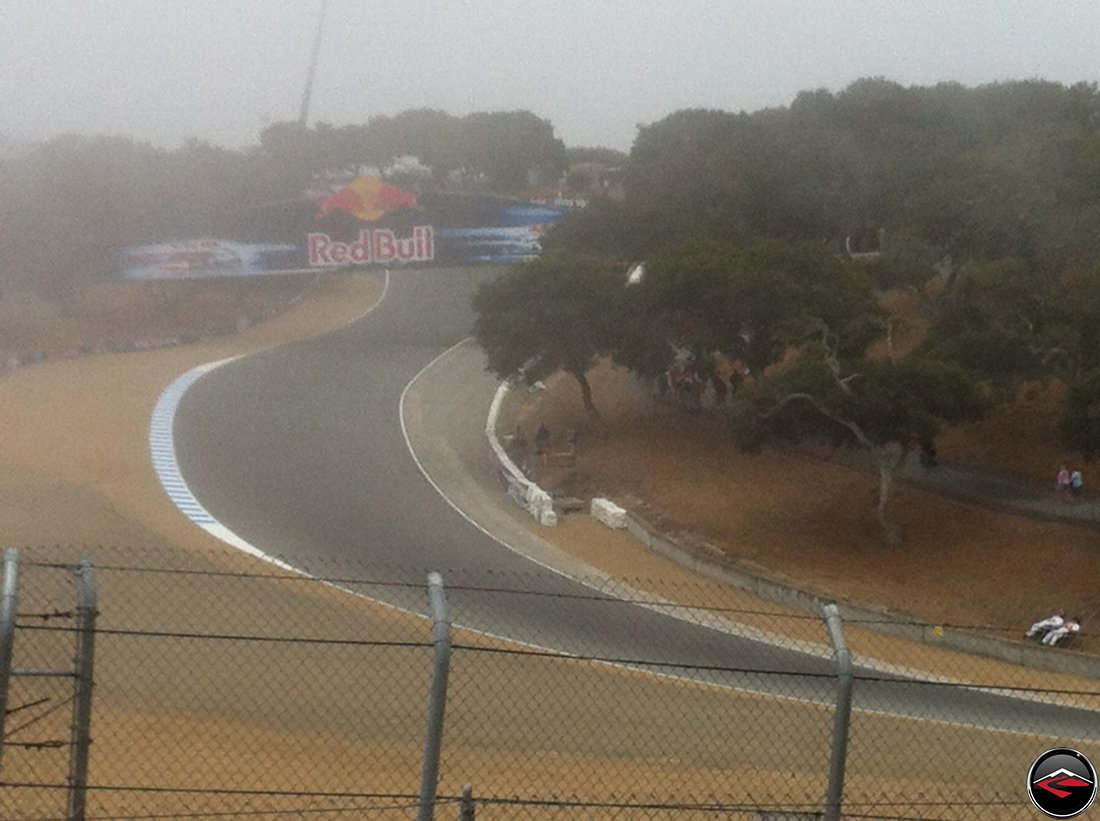 Early morning fog at Mazda Laguna Seca Raceway corkscrew, turns 7, 8 and 9, during Free Practice One, during the 2012 MotoGP Grand Prix