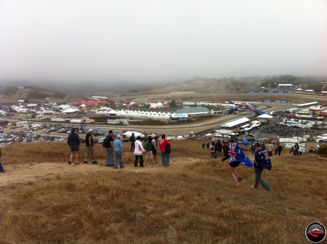 The view from the top of Mazda Laguna Seca Raceway, overlooking turn one and turn two, Ducati Island and all the vendors, in the fog, during the 2012 MotoGP Grand Prix Race weekend