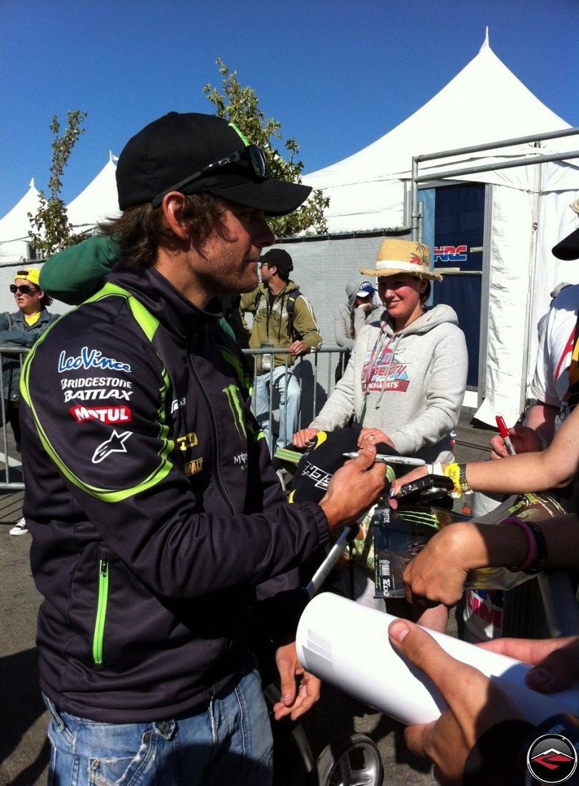 2012 Yamaha Tech 3 Rider, Cal Crutchlow, signing autographs at Laguna Seca raceway