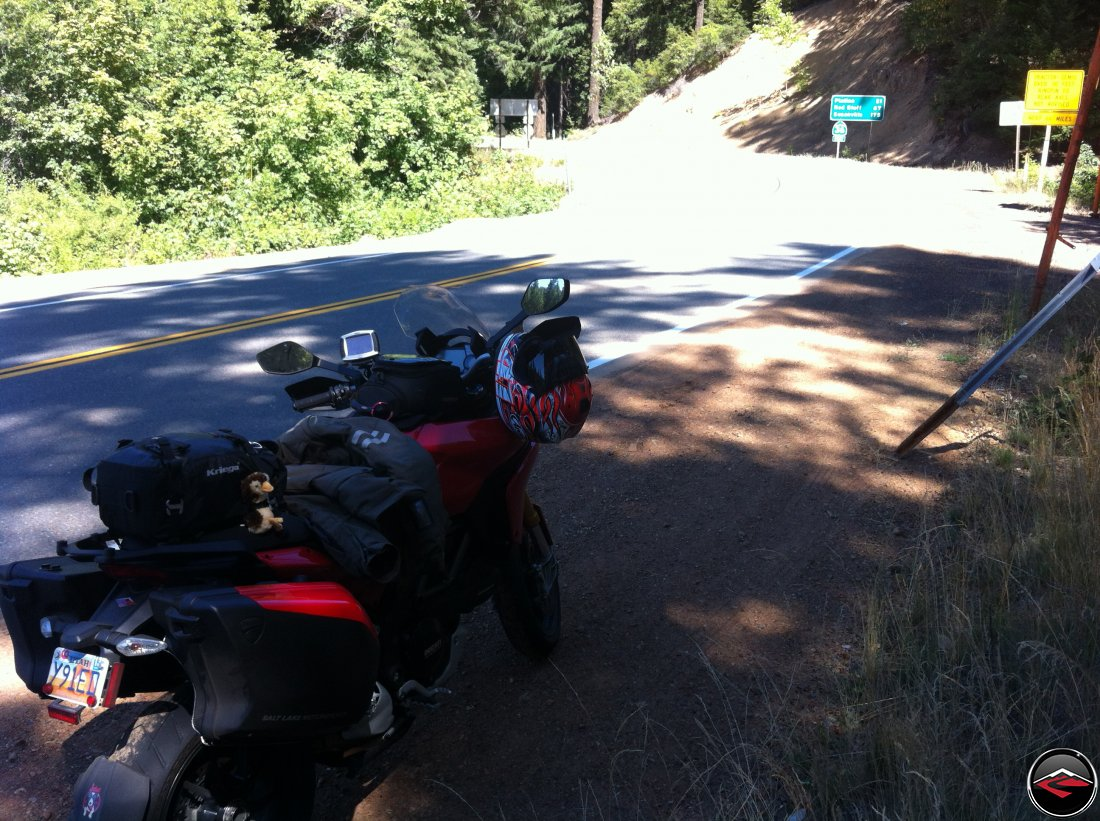 A Ducati Multistrada 1200 parked on the side of the road along California Highway 36, Bramlot Road, at the intersection with California Highway 3